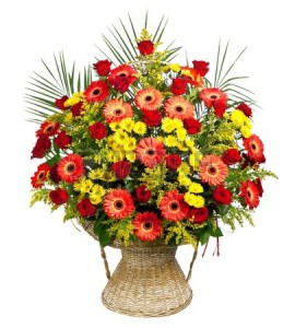 13623064-basket-of-roses-gerberas-and-palm-leaves